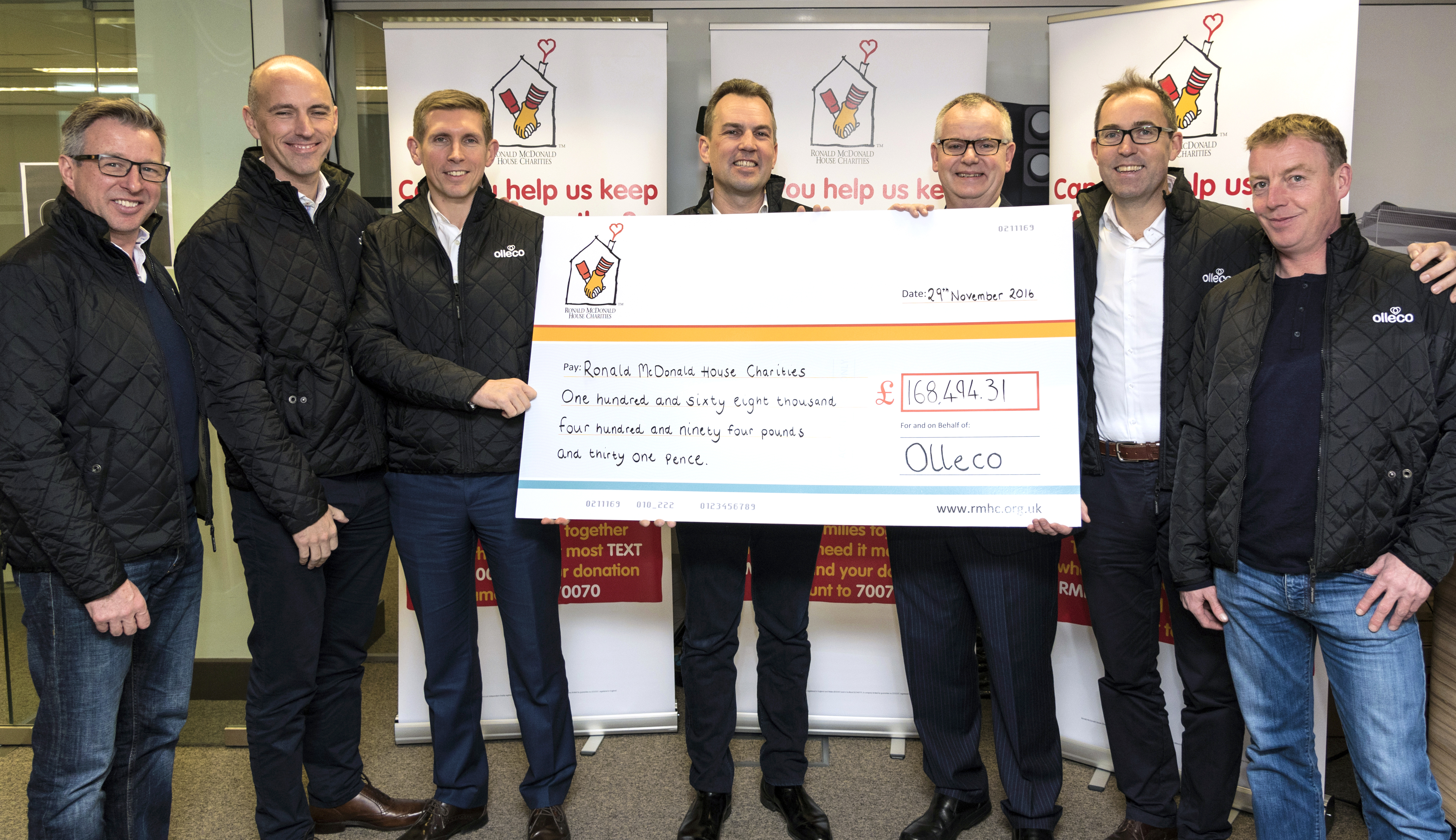 Olleco presenting cheque to RMHC