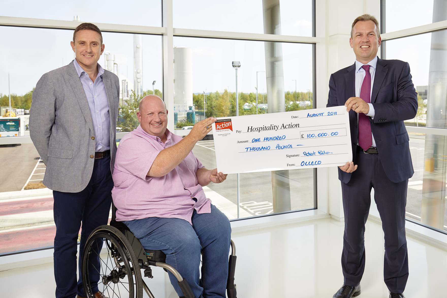 Olleco cheque handover to Hospitality Action
