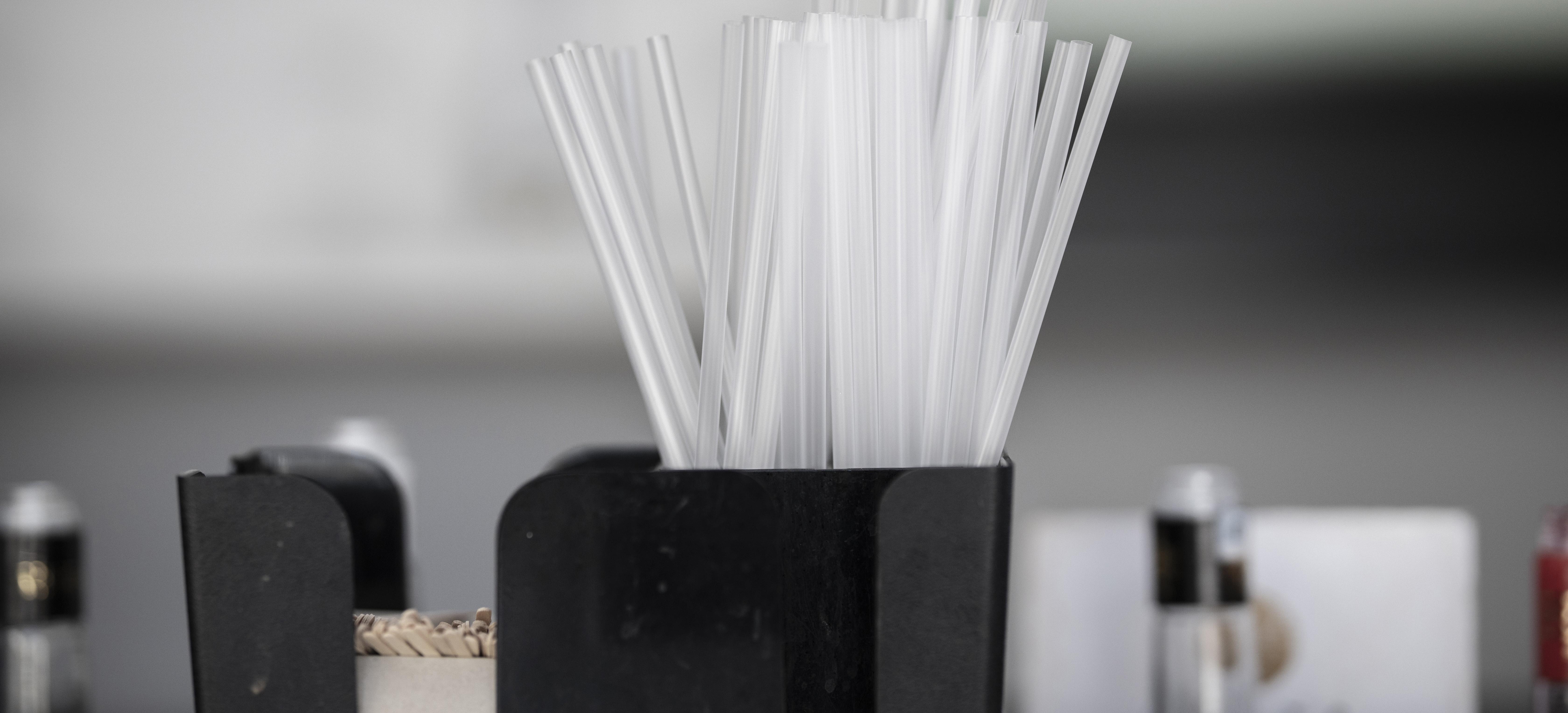 Plastic straws on a restaurant bar