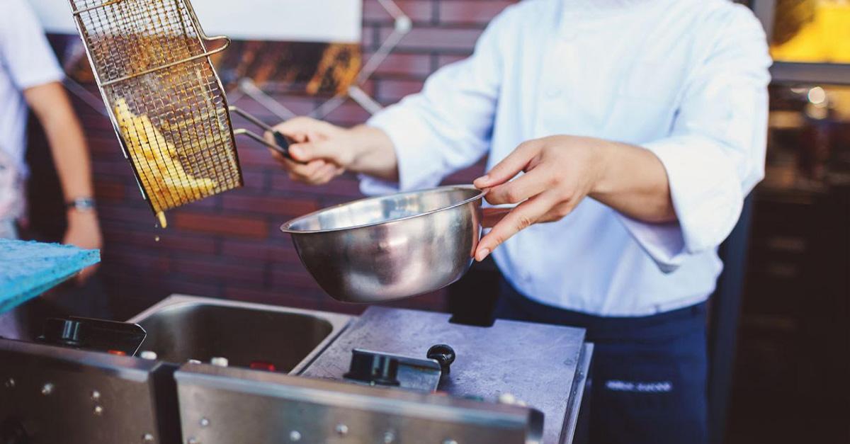 Chips cooking  in deep fat fryer